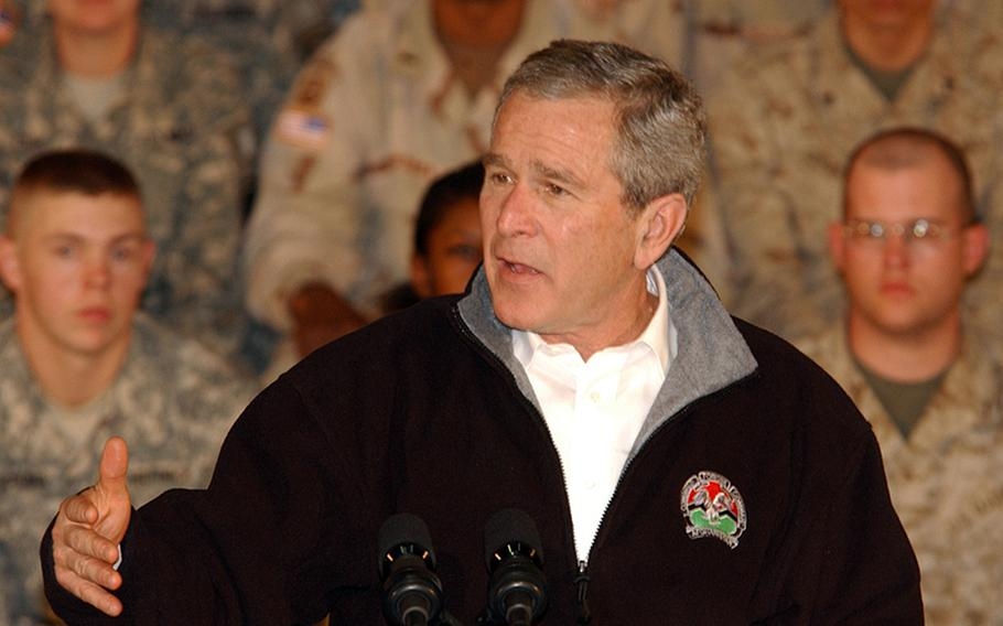 President George W. Bush speaks to a crowd of troops during a surprise visit to Bagram Airfield, Afghanistan, March 1, 2006. Bush thanked the troops for their service and assured them they are making strides towards democracy in Afghanistan.