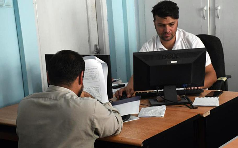 Afghan journalists work in the newsroom of Pajhwok news agency on Sept. 4, 2019. Despite assurances that the Taliban would allow a free media after taking control of the country, rules ban reporting that is contrary to Islam or that insult national figures.