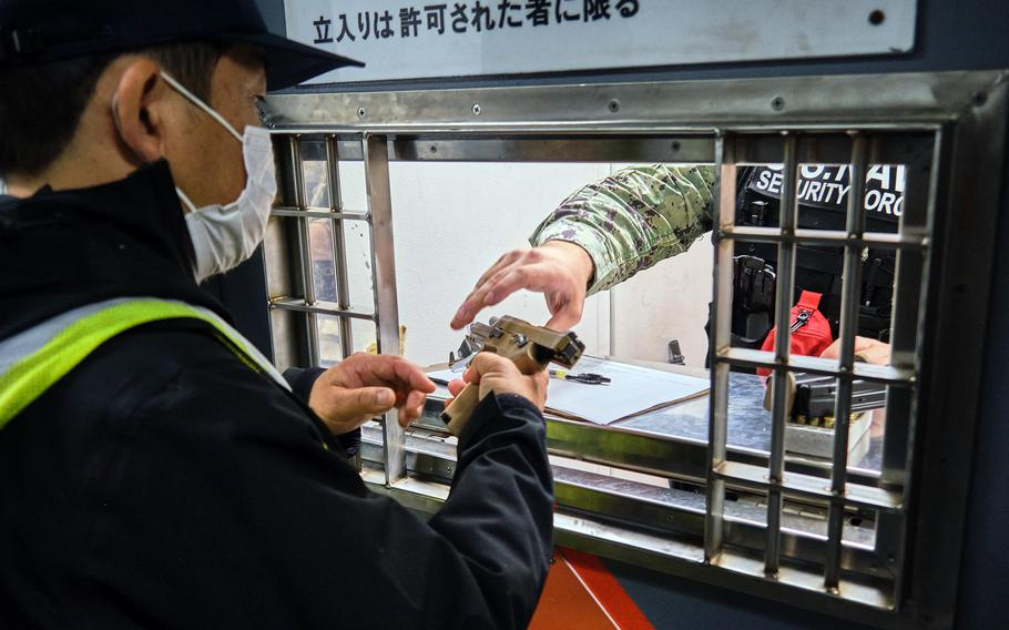 The Navy began issuing new Sig Sauer M18 pistols to security forces personnel at Yokosuka Naval Base, Japan, Friday, Oct. 1, 2021.