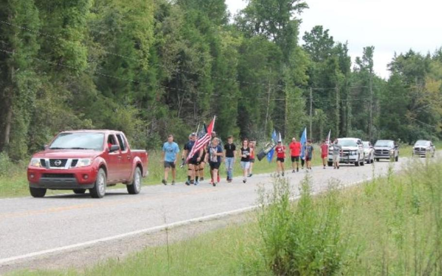 Veterans Robert Hurst and Jarrod Moore are organizing a 21-mile walk on Sept. 11 from Paris to New Blaine, Ark., to remember those who died and to raise awareness about veterans who die by suicide.