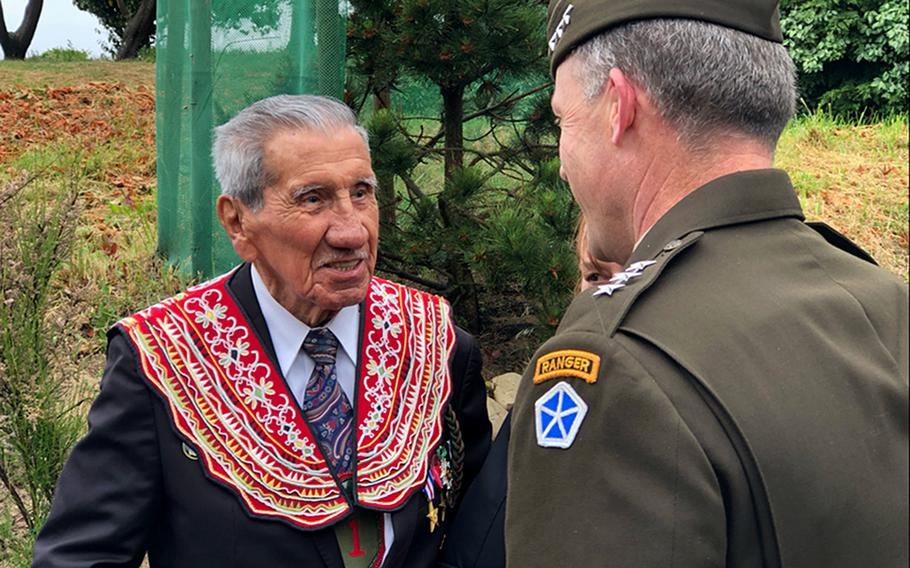 Charles Shay, a veteran of the D-Day landing at Normandy, meets with V Corps commander Lt. Gen. John Kolasheski during a ceremony June 4, 2021, at Omaha Beach. V Corps, which was recently reformed for a new mission in Europe, played a key role in the landing at Omaha Beach 77 years ago.
