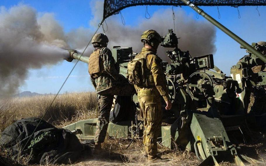 U.S. Marines and Australian soldiers fire an M777 howitzer during the Talisman Sabre exercise at Shoalwater Bay Training Area in Queensland, Australia, July 17, 2021.