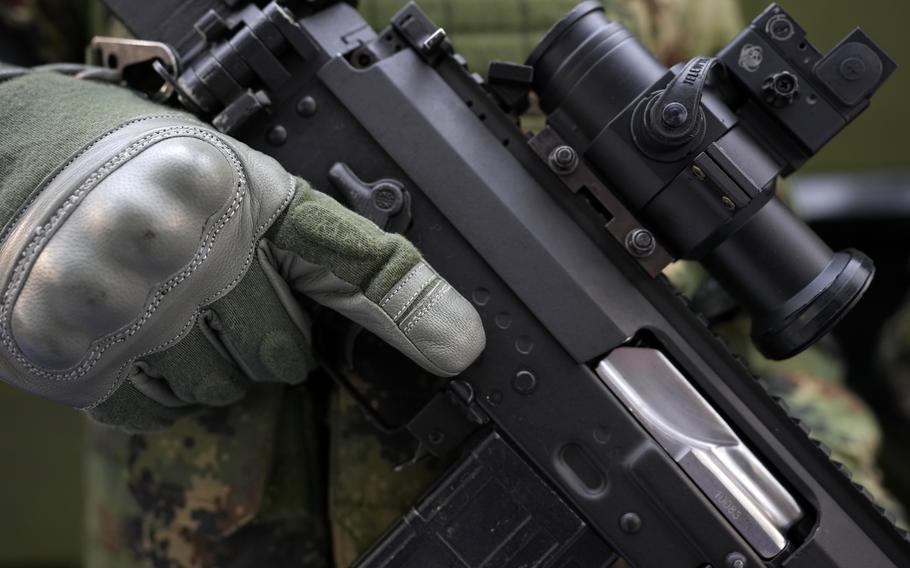 A soldier holds a new M19 rifle made by Serbian armaments company Zastava Arms at an arms fair in Belgrade, Serbia, Tuesday, Oct. 12, 2021.