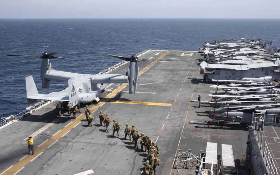"""120p na               IThe Makin Island Amphibious Ready Group, consisting of USS Makin Island (LHD8), USS Somerset (LPD 25), USS San Diego (LPD 22), and embarked 15th Marine Expeditionary Unit; and USS Hershel """"Woody"""" Williams (ESB 4) conduct maritime operations off the coast of Somalia in support of Operation Octave Quartz (OOQ). The OOQ mission is to reposition U.S. Department of Defense personnel from Somalia to other locations in East Africa. (U.S. Navy photo by Mass Communication Specialist 2nd Class Michael J. Lieberknecht)"""