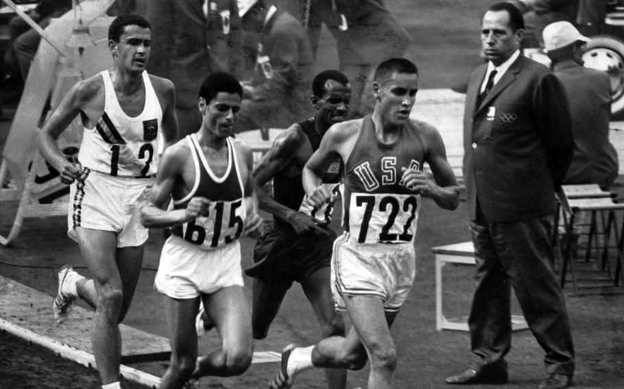 Billy Mills, a U.S. Marine, leads the pack near the 9,000-meter mark during the 10,000-meter run at the Tokyo Olympics in 1964.