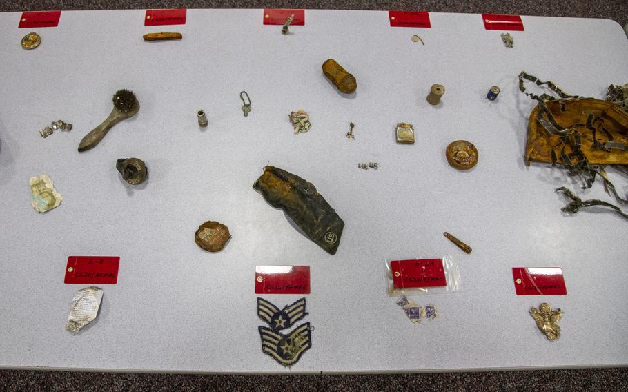 Items found during the Operation Colony Glacier recovery mission are displayed on a table at Joint Base Elmendorf-Richardson, Alaska, June 26, 2020.