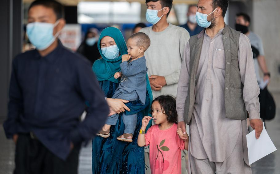 Afghan evacuees arrive at Dulles International Airport in August 2021. The health care needs of many of the evacuees, who are being housed temporarily at the Dulles Expo Center, have taxed Northern Virginia's hospital system, local officials say.