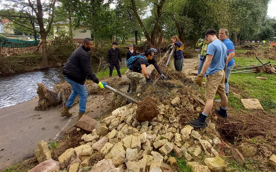 A group of volunteers help clean up the town of Rittersdorf, Germany, July 31, 2021. People from the Spangdahlem and Ramstein military communities volunteered their time following the mid-July flooding of the Nims River.
