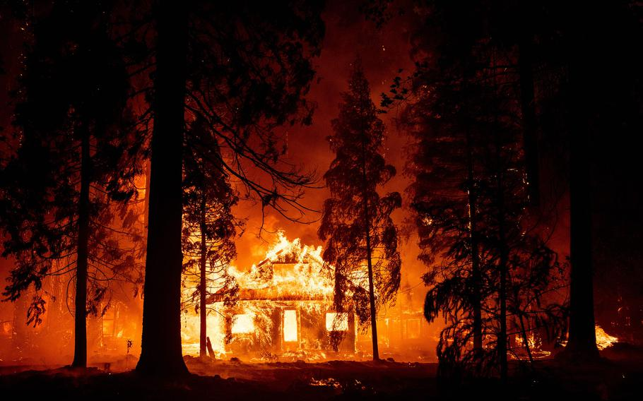A home burns as flames from the Dixie fire tear through the Indian Falls neighborhood of unincorporated Plumas County, Calif., on Saturday, July 24, 2021.