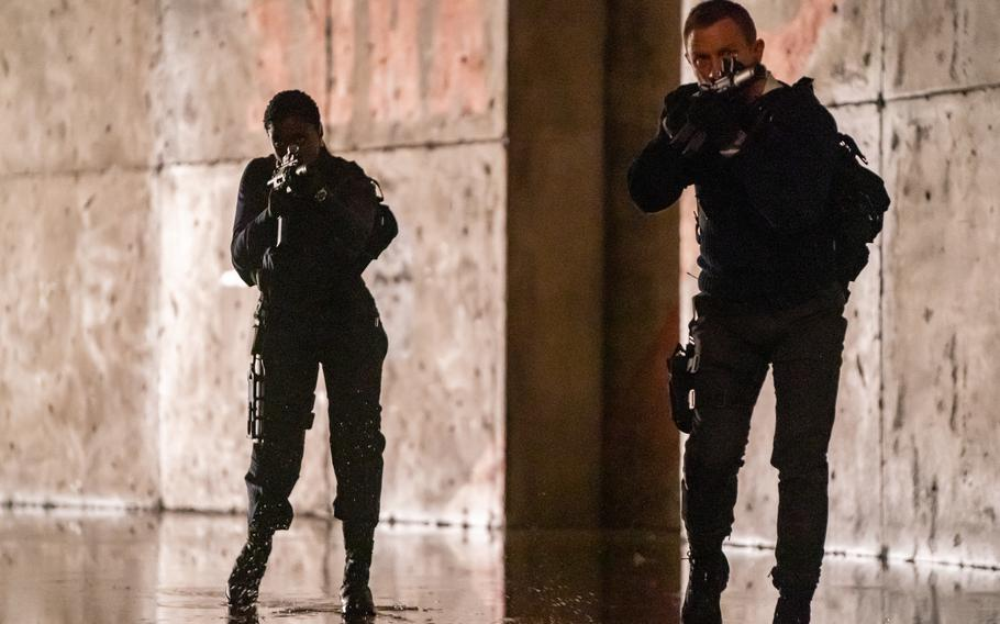 """Lashana Lynch and Daniel Craig are British secret agents in """"No Time to Die,"""" the latest James Bond film, opening this weekend."""
