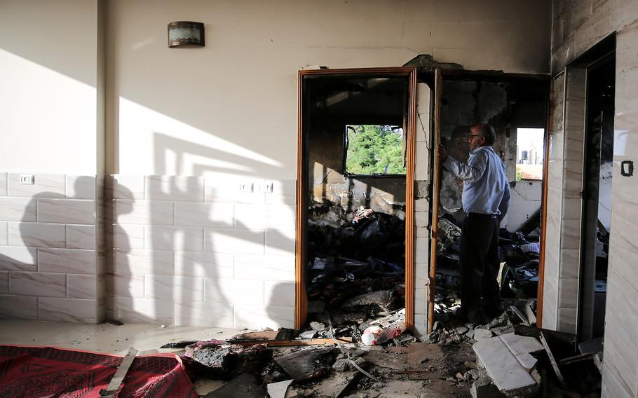 Zakaria Hamad inspects the inside of his home, which was destroyed by an airstrike in Beit Hanoun, Gaza. MUST CREDIT: Photo for The Washington Post by Emad Nassar