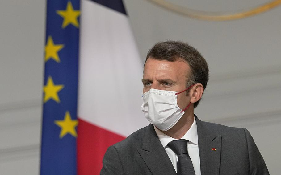 France's President Emmanuel Macron, meets French carmakers at the Elysee Palace in Paris, Monday, July 12, 2021.