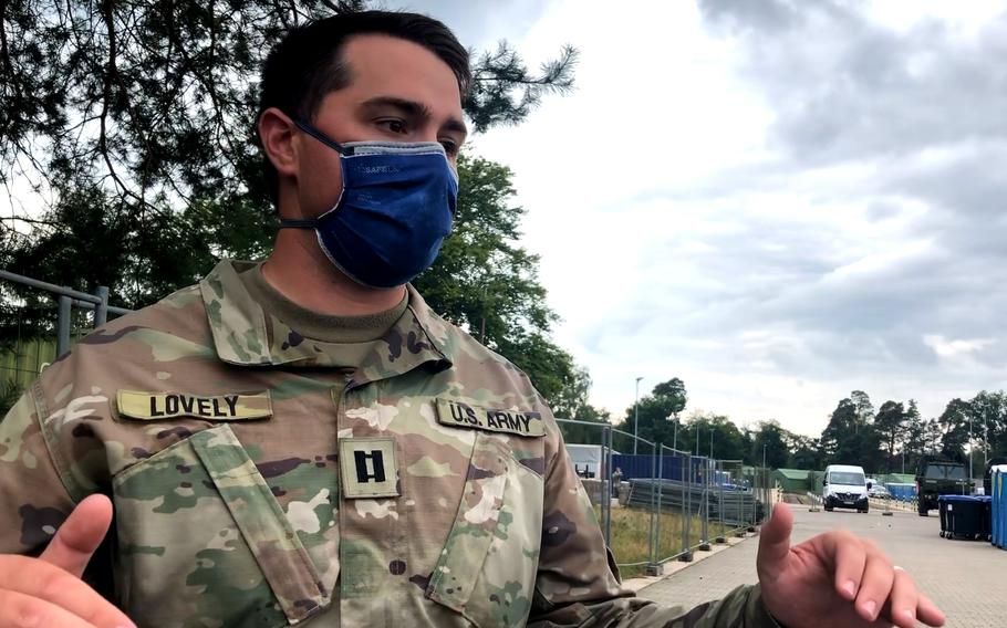 Army Capt. Alex Lovely stands at the site on Rhine Ordnance Barracks in Kaiserslautern, Germany, on Aug. 30, 2021, where more facilities are being installed to take in an additional 3,000 Afghan evacuees. The Army has already provided shelter for more than 3,000 evacuees at the site, to ease the burden on Ramstein Air Base, where some 24,000 Afghans have arrived since mid-August.