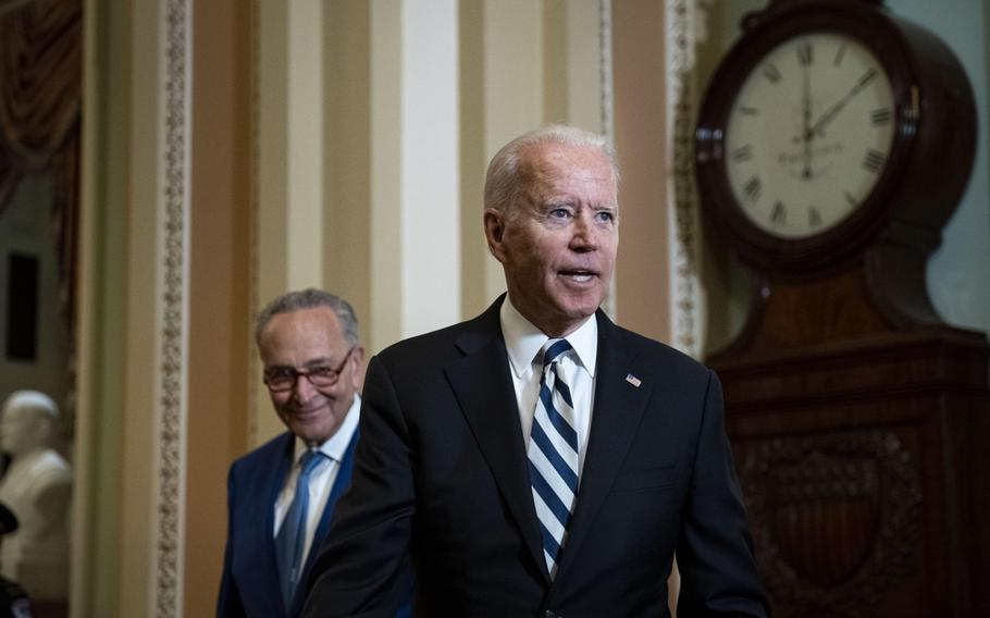President Joe Biden speaks to members of the media with Senate Majority Leader Chuck Schumer, D-N.Y., left, at the U.S. Capitol in Washington, D.C., on July 14, 2021.