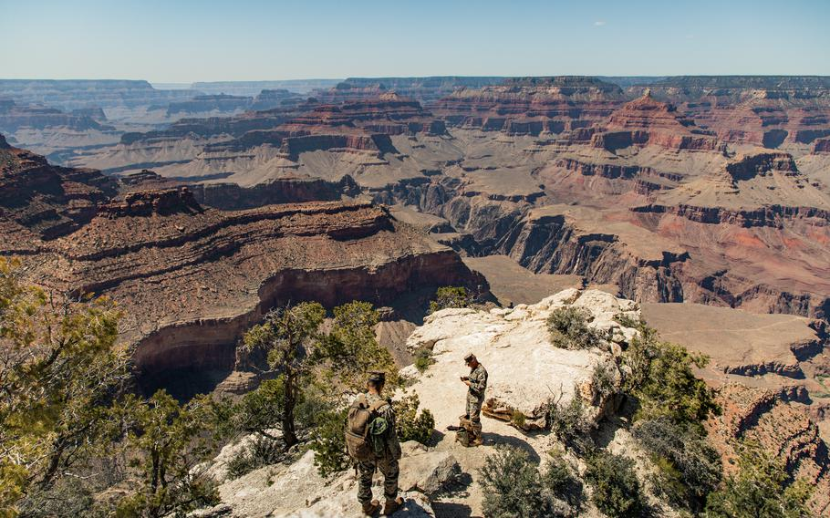 Marine Staff Sgt. Coltin Davenport, regimental communications chief, right, and Cpl. Owen Trinidad, a field radio operator, set up a radio antenna in the Grand Canyon, near Grand Canyon Village, Ariz., May 14, 2021. Marines with the 2nd Transportation Battalion, Combat Logistics Regiment 2, 2nd Marine Logistics Group drove from Camp Lejeune, N.C., to Twentynine Palms, Calif., in one of the longest convoys in the service's history.
