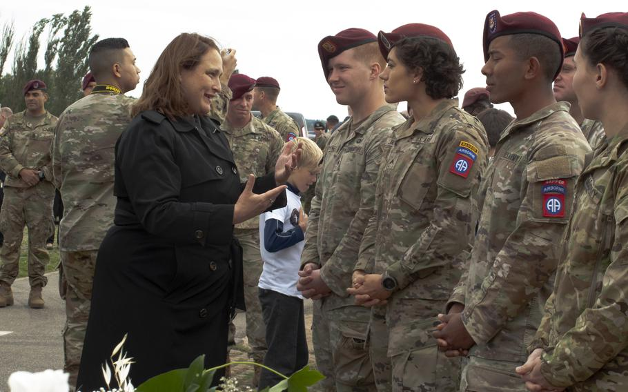 U.S. Embassy charge d'affaires Marja Verloop speaks with 82nd Airborne Division soldiers after a ceremony on Sept. 20, 2021, in Nijmegen, Netherlands, to mark the 77th anniversary of the Waal River crossing by U.S. paratroopers.