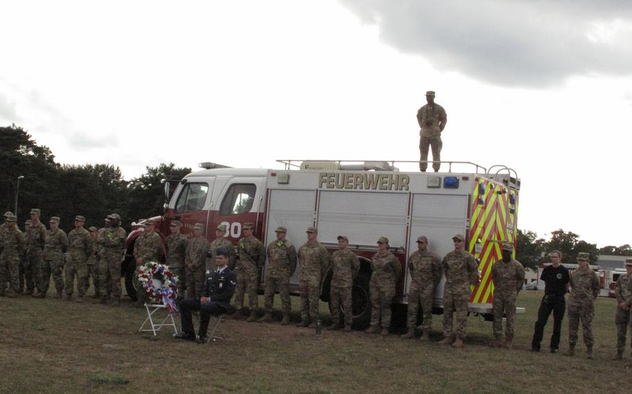 First responders listen to Maj. Gen. Randall Reed at a ceremony at Ramstein Air Base, Germany, on Sept. 10, 2021, to mark the 20th anniversary of 9/11.