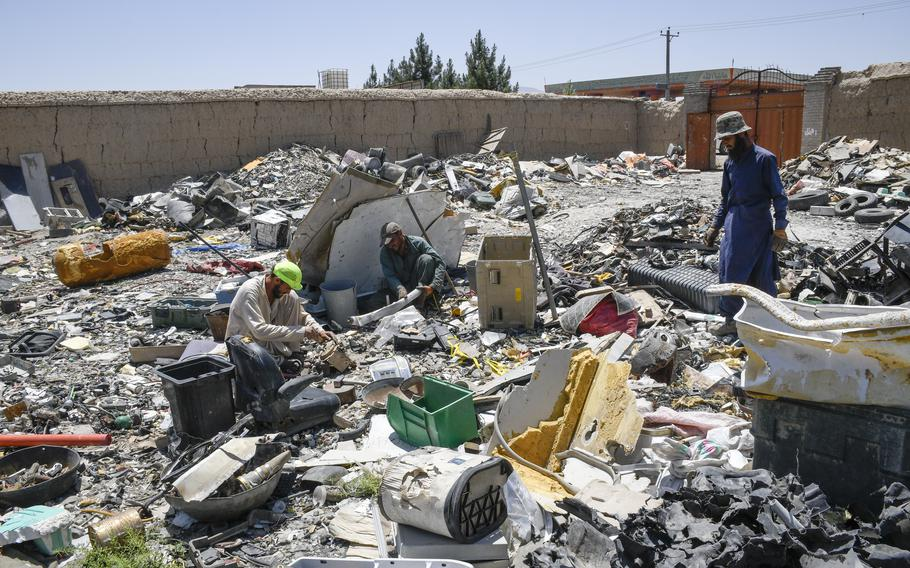 Workers at trash yards near Bagram Airfield, Afghanistan pick through garbage from the base June 5, 2021. While many of the items leaving the base have been crushed or ruined, some have copper or iron that can be recycled and resold.