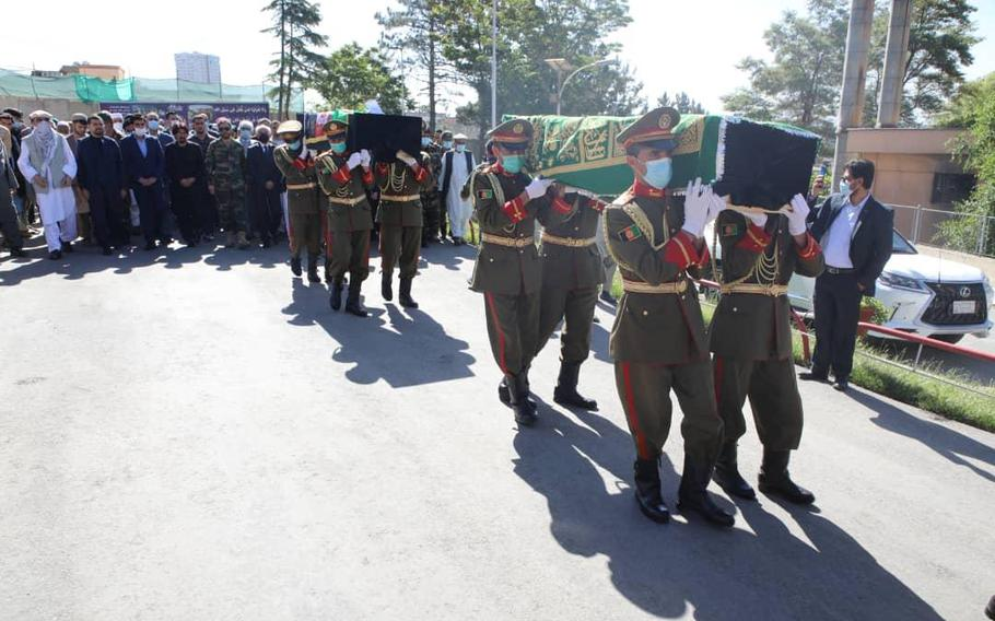 The caskets of Afghan elite soldiers killed in a battle with the Taliban are carried during a funeral in Kabul, June 19, 2021. One of the three soldiers remembered at the funeral was Maj. Sohrab Azimi, who was trained and educated by the United States.