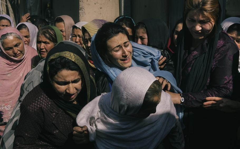 Family members attend a funeral in May for Niazi, an Afghan National Army soldier who was killed after his outpost was surrounded by the Taliban.