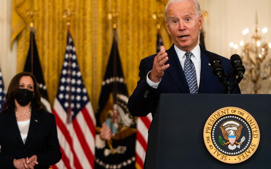President Biden, with Vice President Harris by him, answers questions after delivering remarks regarding the Senate passage of the bipartisan infrastructure bill at the White House on Aug. 10, 2021.