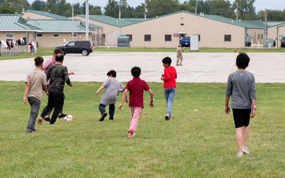 Afghan evacuees play soccer together Saturday, Sept. 4, 2021, at Camp Atterbury, Ind. The division soldiers along with Indiana National Guard soldiers will provide transportation, temporary housing, medical screening and logistics support as part of Operation Allies Welcome.