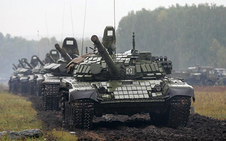 Russian tanks roll at the Pravdinsky range in Russia during Zapad 2017, a Russia-Belarus exercise. The countries say they will have about 12,800 troops taking part in this year's upcoming event, which takes place every four years.