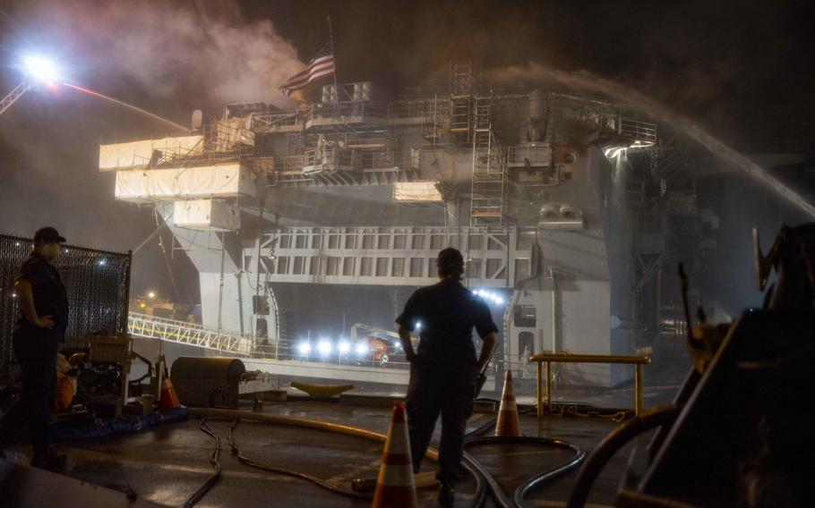 Sailors combat a fire aboard the amphibious assault ship USS Bonhomme Richard (LHD 6) on July 13, 2020, in San Diego.