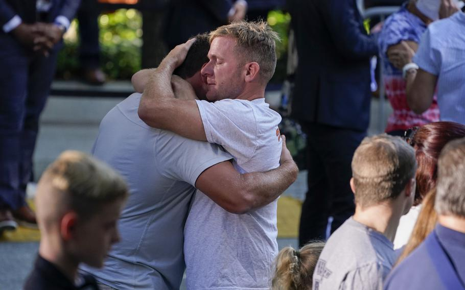 Embraces and tears at a ceremony marking the 20th anniversary of the Sept. 11, 2001, terrorist attacks at the National September 11 Memorial and Museum in New York, Saturday, Sept. 11, 2021.