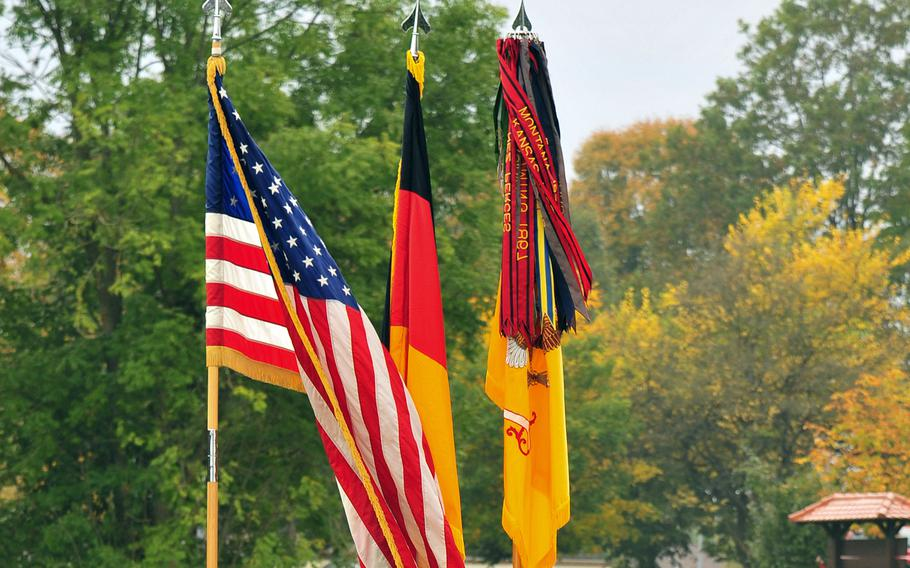 The American and German flags and the 2nd Cavalry Regiment colors are displayed during a change of responsibility ceremony at Rose Barracks in Vilseck, Germany. The Army is offering a $2,000 reward for information leading to the arrest and conviction of anyone responsible for stealing the American and German flags from inside the headquarters building, and raising the Confederate flag outside, earlier this week.