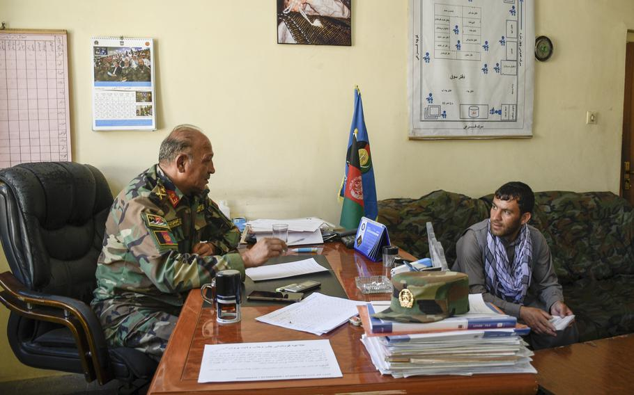 Lt. Col. Atiqullah Tarin, a recruiter for the Afghan army, speaks to Nasir Rahimi, in Charikar, Afghanistan June 5, 2021. Rahimi reenlisted as part of a drive to find 1,500 troops to replace departing U.S. and NATO troops at Bagram Airfield.
