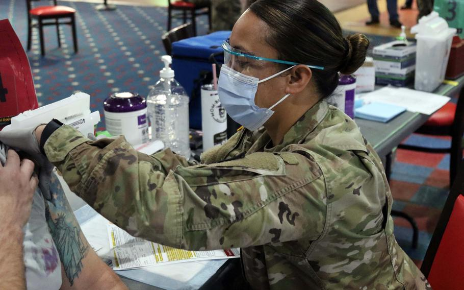 A soldier at Fort Bragg in North Carolina administers a coronavirus vaccine in February.