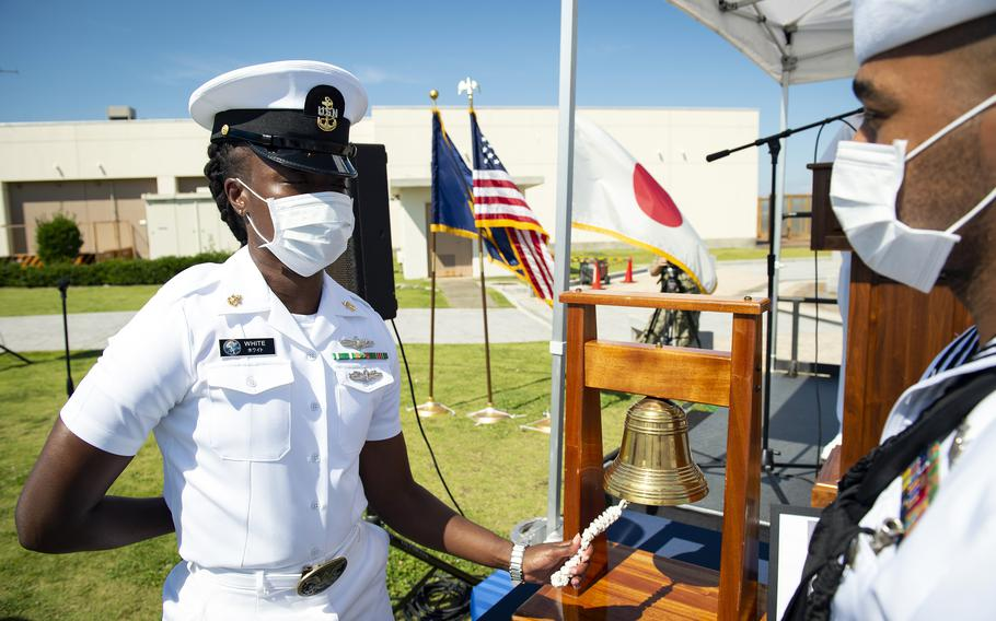 A sailor rings a bell to honor the fallen during the first Bells Across America ceremony at Yokosuka Naval Base, Japan, Thursday, Sept. 23, 2021.
