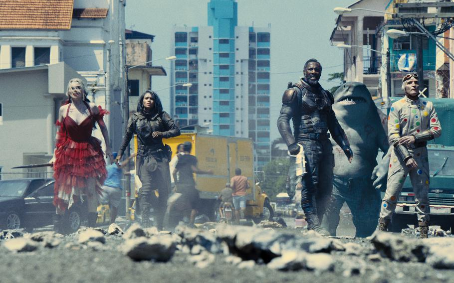 """This image provided by Warner Bros. Pictures shows Margot Robbie, from left, Daniela Melchior, Idris Elba and David Dastmalchian in a scene from """"The Suicide Squad."""""""