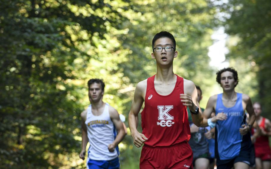 Daniel Lee, a runner at Kaiserslautern, paces himself during the beginning of a high school boys' varsity cross country race Saturday, Sept. 18, 2021, in Kaiserslautern, Germany.