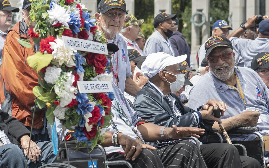 Army veteran Billy Reed, right, shares a laugh with fellow veterans at the World War II Memorial in Washington, D.C., on Wednesday, Aug. 18, 2021, prior to the start of an Honor Flight ceremony that paid tribute to veterans from World War II, the Korean War and the Vietnam War.