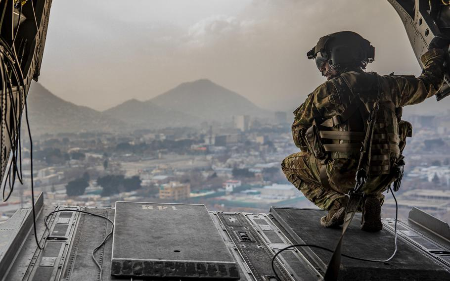 A U.S. soldier assigned to the 10th Mountain Division surveys the back of a CH-47 Chinook during flight over Kabul, Afghanistan on March 3, 2020.