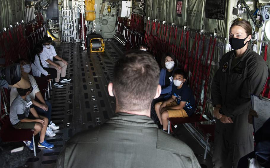 Marine Cpl. Andrew Campbell, a KC-130J Super Hercules loadmaster, tells Japanese chidren about the missions the aircraft has supported over the years, during a tour of Marine Corps Air Station Iwakuni, Japan, Thursday, Sept. 23, 2021.