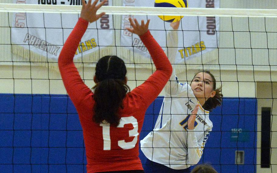 Yokota's Elena Haas spikes against Nile C. Kinnick's Cierra San Nicolas during Saturday's Japan girls volleyball match. The Red Devils won in straight sets.