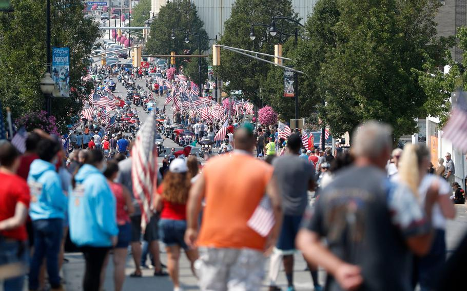 """Thousands of people on motorcycles drive past the crowd during the funeral procession for Marine Corps Cpl. Humberto """"Bert"""" Sanchez at the corner of 8th Street and East Market Street on Sept. 12, 2021, in Logansport, Ind."""