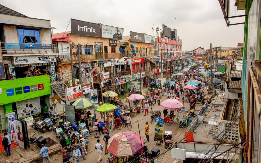 Crowds of shoppers walk through the Ikeja computer village market in Lagos, Nigeria, on March 29, 2021.