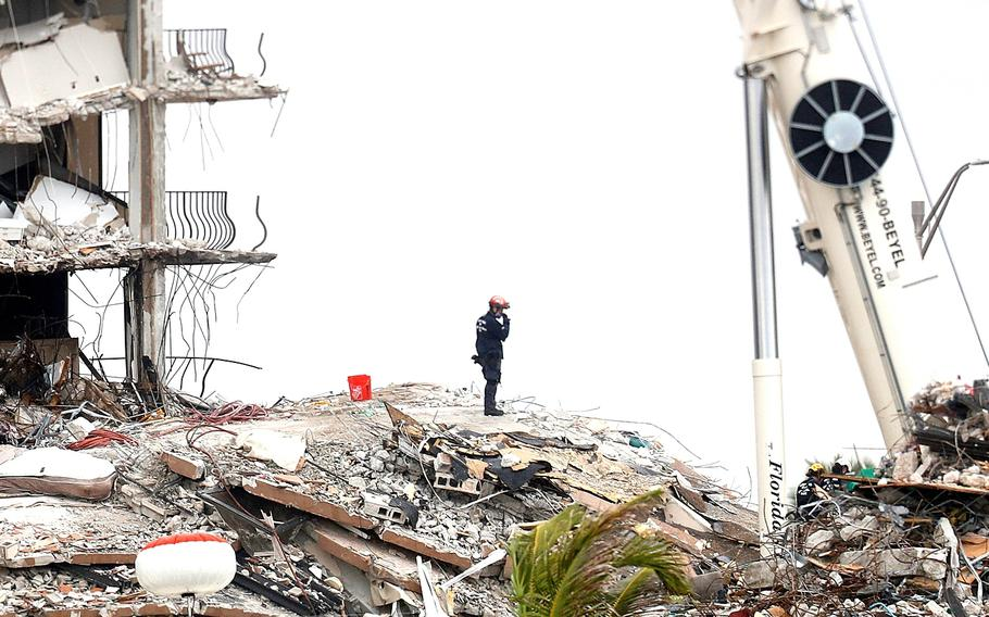 Search-and-rescue crews are working to recover missing people who were in the Champlain Towers South condominiums when it collapsed last week in Surfside, Fla., June 28, 2021.