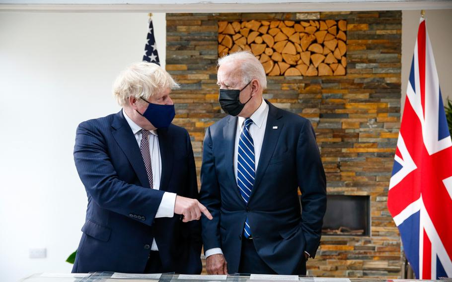 Prime Minister Boris Johnson and President Joe Biden during their bilateral meeting in Carbis Bay, U.K., on June 10, 2021. Virus reproduction numbers published on Friday, Aug. 13, 2021, indicate COVID-19 is in retreat in five of England's seven regions and in the nation as a whole, good news for Johnson.