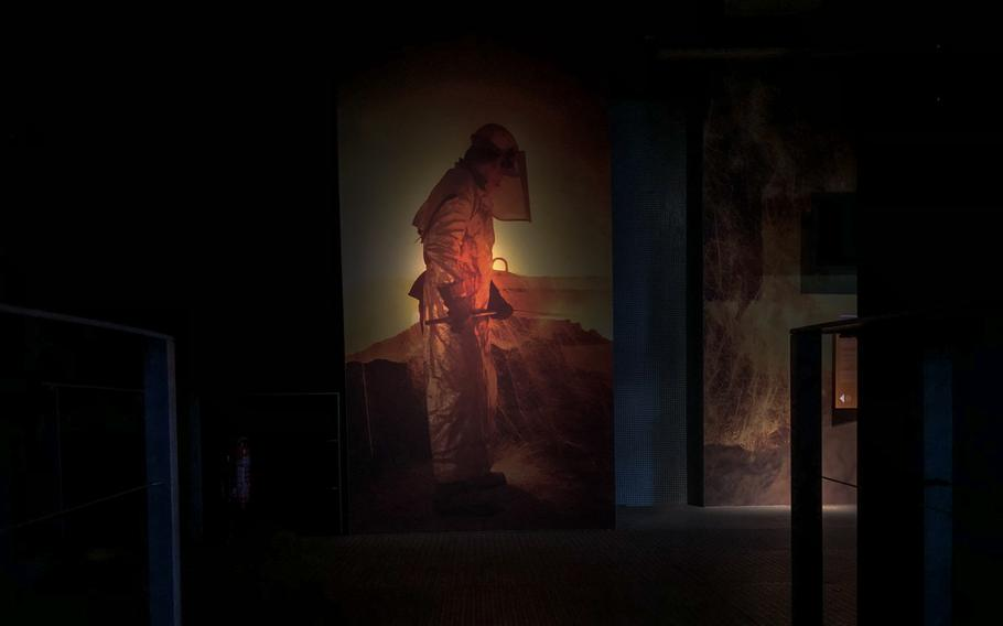An image of an iron worker is projected onto the wall at Voelklingen Ironworks in Voelklingen, Germany.