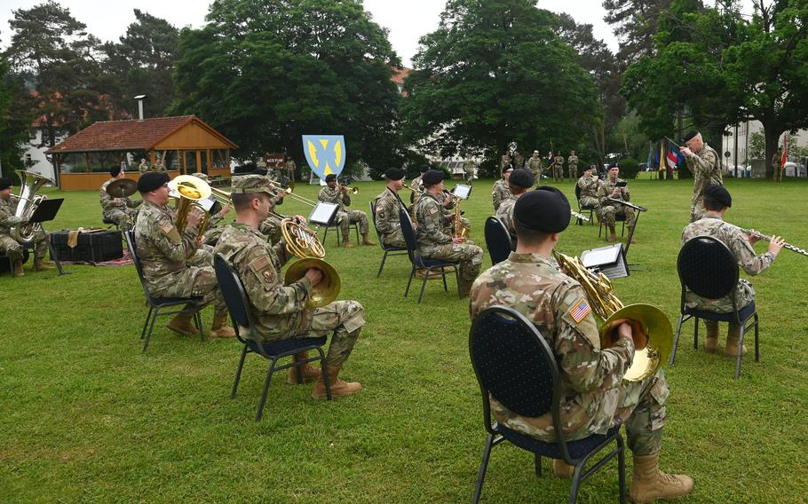The U.S. Army Europe and Africa Band plays at the 21st Theater Sustainment Command's change of command ceremony at Daenner Kaserne, Kaiserslautern, Germany, June 8, 2021. Brig. Gen. James Smith took command from Maj. Gen. Christopher Mohan at the ceremony.