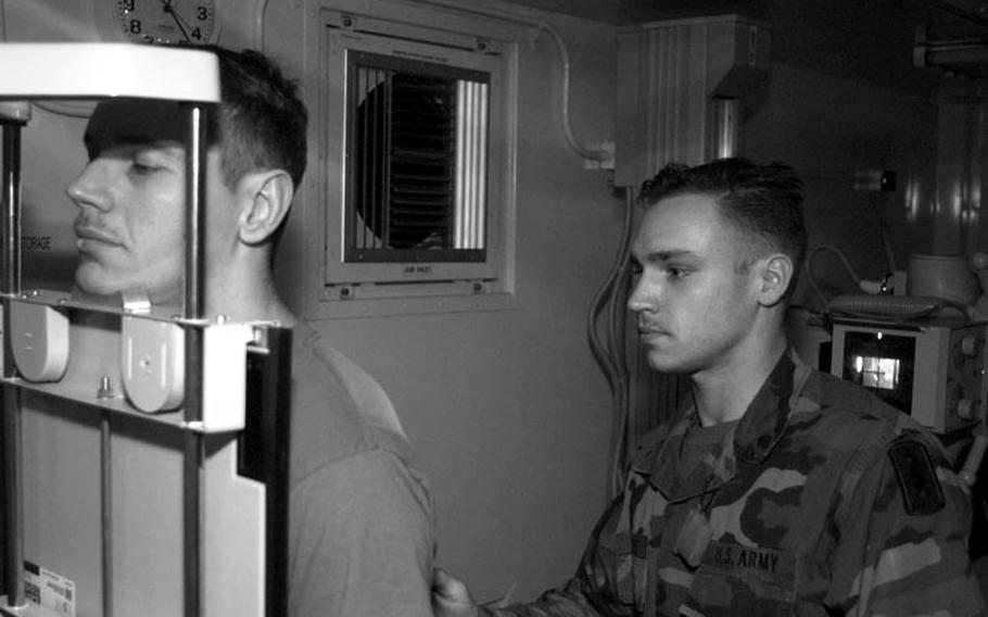 Taszar AB, Hungary, January, 1996: An Army corpsman takes X-rays of a patient at Taszar's medical facility, one of the most advanced field hospitals ever deployed.