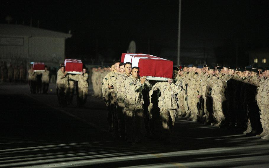 More than 3,000 soldiers from NATO countries lined the ramp at Kandahar Airfield in March 2009 to pay final respects to four Canadian troops killed in makeshift bomb explosions. Maj. Gen. Wayne Eyre, acting head of Canadian forces, wrote a public letter acknowledging questions about the legacy of their time in Afghanistan, after the Taliban took control of Panjwai district in southern Kandahar province, where many Canadians fought and died.
