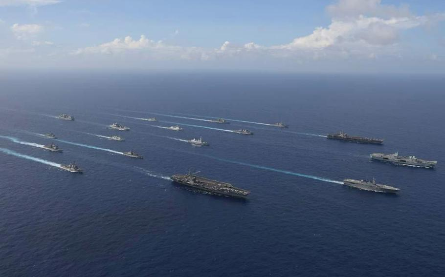 The aircraft carriers USS Ronald Reagan, USS Carl Vinson and HMS Queen Elizabeth join the Japanese helicopter destroyer JS Ise in leading vessels from six nations through the Philippine Sea near Okinawa in this undated photo from the Japan Maritime Self-Defense Force.