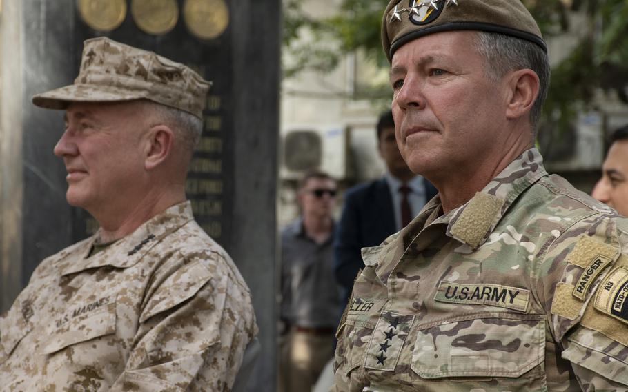 Army Gen. Scott Miller, right, sits next to Marine Corps Gen. Frank McKenzie at a ceremony in Kabul, Afghanistan, on Monday, July 12, 2021. Miller relinquished command of United States Forces-Afghanistan and NATOs Resolute Support mission to McKenzie.