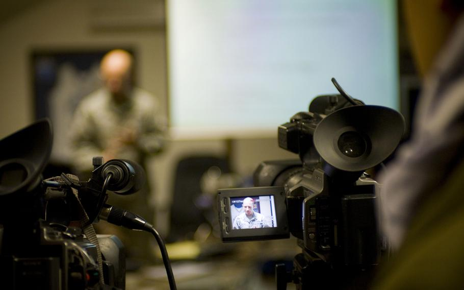 A cameraman captures a briefing at Bagram Airfield, Afghanistan, in 2009. Afghans who worked with American news companies should be given emergency visas to relocate to the United States, a group of media outlets and press freedom organizations have said.